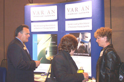Exhibitor Glenn Barrow of Varian speaks with attendees