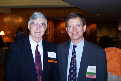 Speaker Dr. Carl Bogardus (left) and board member Paul Williams.